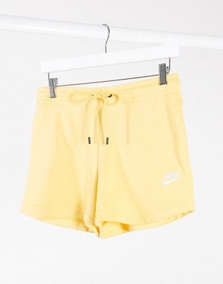 Nike essentials shorts in yellow
