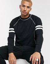 Asos Design DESIGN organic relaxed long sleeve raglan t-shirt with sleeve stripes and contrast stitching in black