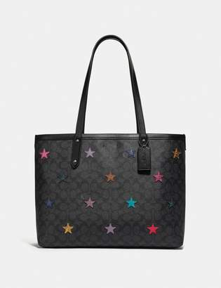Coach Central Tote In Signature Canvas With Star Applique And Snakeskin Detail