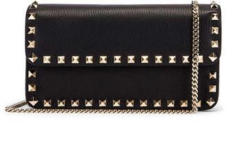 Valentino Rockstud Flap Crossbody Bag in Black | FWRD