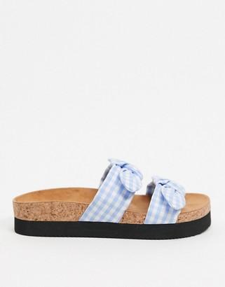 Monki Anok gingham bow flat sandals in light blue check