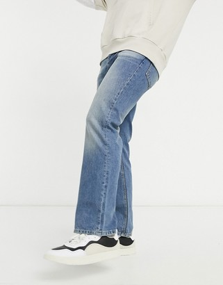 ASOS DESIGN bootcut jeans in mid wash blue