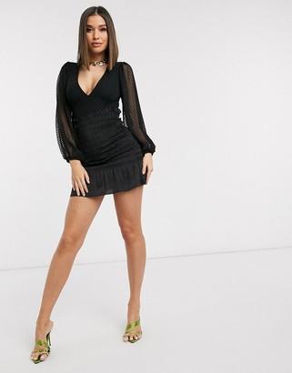 NEVER FULLY DRESSED Jojo shirred mini skirt in black