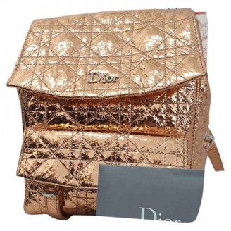 Christian Dior Gold Leather Backpacks