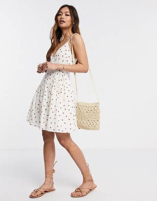 ASOS DESIGN tie wrap around crinkle mini sundress in spot print