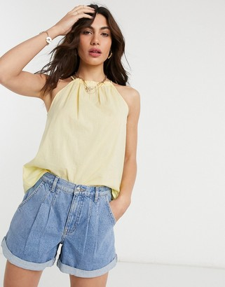 Vero Moda sleeveless top with high neck in seersucker yellow stripe