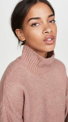 Frame Side Slit Mock Neck Sweater