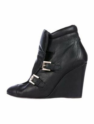 Chanel Embossed Signature Logo Boots Black
