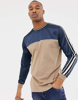 Asos Design DESIGN relaxed longline long sleeve t-shirt with contrast satin yoke and shoulder taping in navy