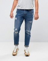 Asos Stretch Slim Jeans With Rips In Mid Blue Wash
