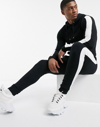Asos DESIGN tracksuit muscle hoodie & super skinny joggers in black with side stripe