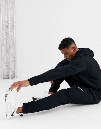Nike Training Dri-Fit tapered fleece joggers in black