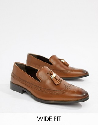 Asos Design DESIGN Wide Fit brogue loafers in tan leather with gold tassel detail