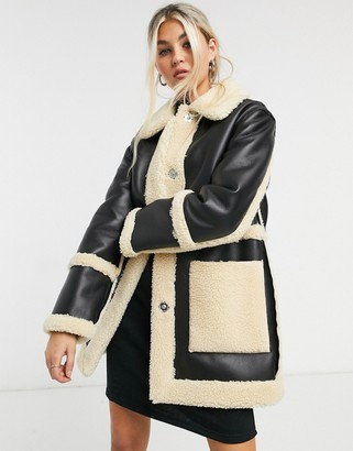 Topshop reversible borg shacket in black and cream
