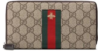 Gucci Web GG Supreme zip around wallet