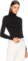 Calvin Klein Interlock Jersey Turtleneck in Black.