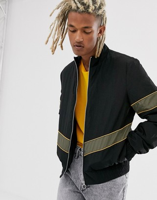 Asos Design DESIGN windbreaker in black with contrast panelling