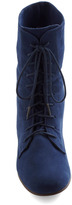 Lady in Rad Boot in Navy