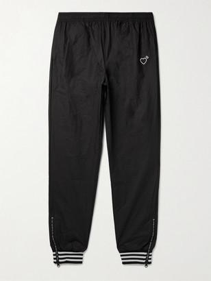 adidas Consortium - Human Made Tapered Logo-Print Striped Crinkled-Shell Track Pants - Men - Black