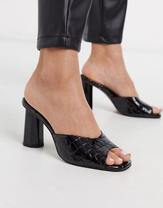 CHIO heeled mules in black croc effect leather
