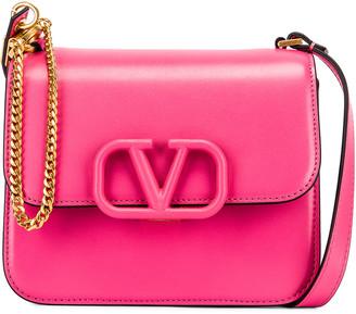 Valentino Small VSling Shoulder Bag in Mac Rose | FWRD