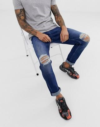 Asos Design DESIGN stretch slim jeans in dark wash blue with knee rips