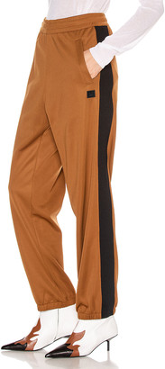 Acne Studios Face Trousers in Caramel Brown | FWRD