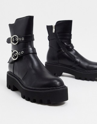 Lamoda chunky flat boots with double buckle in black