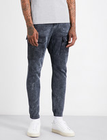 Stone Island Tapered regular-fit mid-rise cotton-blend trousers
