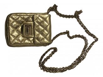 Chanel 2.55 Gold Leather Handbags