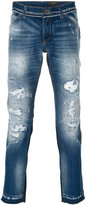 Dolce & Gabbana distressed jeans - men - Cotton/Calf Leather - 48