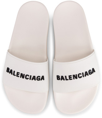 Balenciaga Rubber Logo Pool Slides in White & Black | FWRD