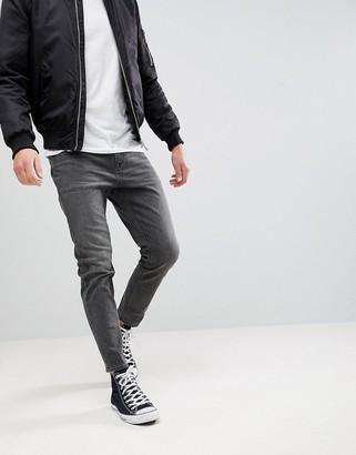 ASOS DESIGN tapered jeans in vintage washed black