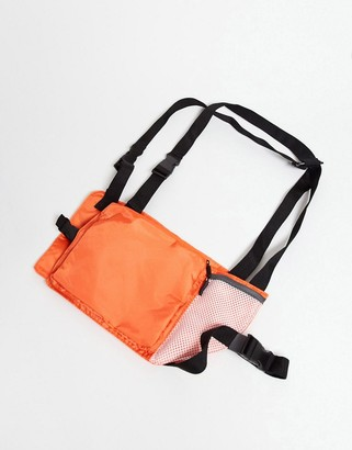 ASOS DESIGN harness bag with orange with mesh detail