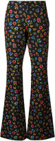 Moschino flower power flared trousers - women - Cotton/Rayon - 40