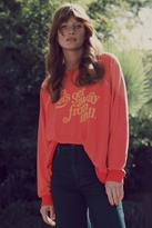 beyonce knowles  Who made  Beyonce Knowles red print sweatshirt?