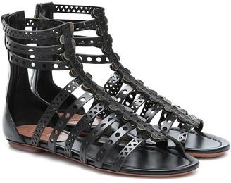 Alaã ̄A Laser-cut leather sandals