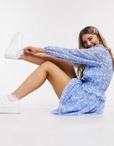 Asos Design DESIGN wrap front shirred waist mini skater dress in floral print