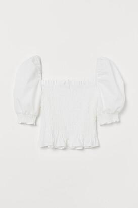 H&M Short-sleeved Smocked Blouse