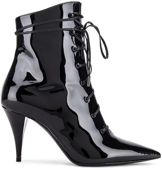 Saint Laurent Kiki Lace Up Ankle Booties in Black | FWRD