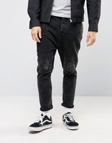 Asos Drop Crotch Jeans With Rip And Repair In Black