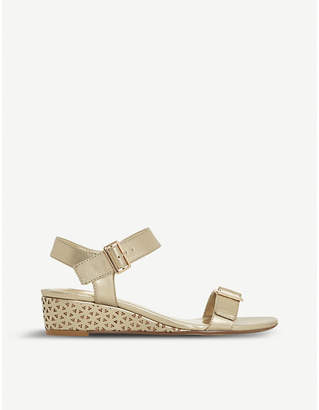 Dune Karinaa laser cut metallic wedge sandals