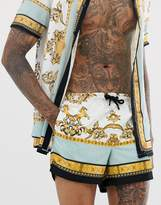 Siksilk SikSilk co-ord swim shorts in white and gold print