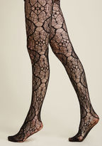 9988 Have you ever spied a pair of black tights as intricate as the ones before you? There's something ever-so-entrancing about the woven, web-like motif of this haute hosiery - something that alludes to the myriad of marvelous ways you can style up their divi