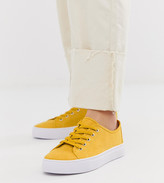 Asos Design DESIGN Wide Fit Dusty lace up sneakers in mustard