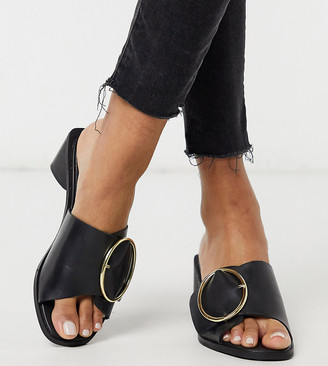 Justice ASRA Exclusive mules with statement buckle in black leather