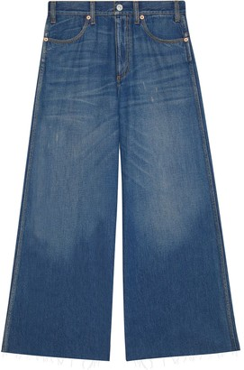 Gucci Wide leg denim trousers with patch