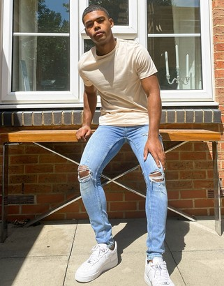 Topman spray on jeans with rips in blue