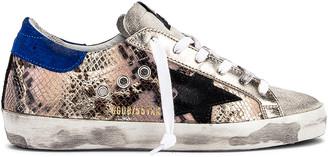 Golden Goose Superstar Sneaker in Python & Black Star   FWRD