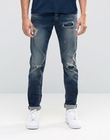 Jack and Jones Slim Fit Jeans in Mid Blue wash with Rip Repair Detail